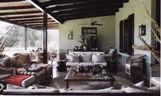 Kathy Waddell's house near Plett, via South of the Sahara: deep verandah, Malawi chairs Outdoor Rooms, Outdoor Living, Porches, Balinese Interior, African Furniture, African Interior, British Colonial Style, Outside Living, Love Home