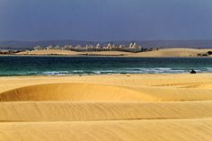The unique display of waves of sand and water in the Chaves sand dunes.   At Boa Vista Island, Cape Verde