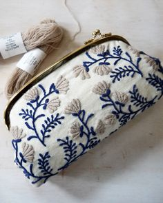 Beautiful little clutch. Like the colors. Fun embroidery project, perhaps? Gotta find a clutch…..