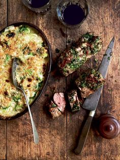 Serve this herb-crusted lamb and creamy, cheesy leek and brussel sprout gratin as a Sunday roast alternative or as part of a laid back dinner party menu.