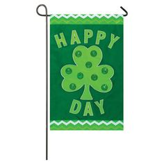 Welcome guests to your garden with this colorful flag, featuring a shamrock print for seasonal appeal.  Product: Garden flag