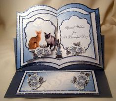 """Stunning easel card for the cat lover features an open book . The left page features two cats sitting together. The right page features the sentiment """" Special Wishes For A Purr-fect Day"""""""