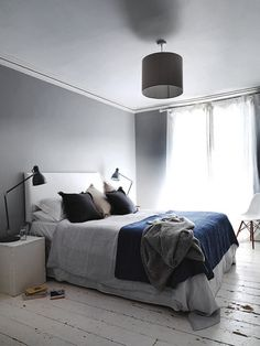 Soft colors, drapes linen and worn white floorboards in Bristol via My World Apart. #eames #bedroom #grey