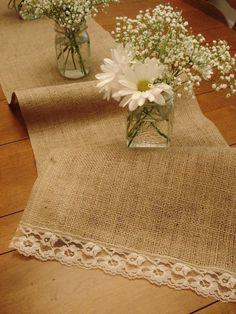 Like the lace on the burlap. Easy flower arrangement with baby's breath.