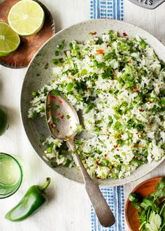 Cilantro Lime Rice Recipe - Love and Lemons Move over Chipotle! This cilantro lime rice recipe is easy, bright, and fresh. The perfect side dish for Mexican or Asian dishes and an essential component in burritos or bowls! Rice Recipes, Side Dish Recipes, Mexican Food Recipes, Whole Food Recipes, Vegetarian Recipes, Healthy Recipes, Cilantro Recipes, Healthy Dishes, Healthy Cooking