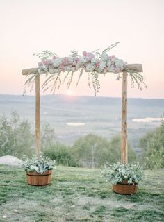 Bamboo wedding arch with pink and white flowers via Andy Barnhart