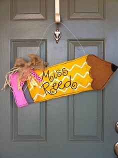 Hey, I found this really awesome Etsy listing at http://www.etsy.com/listing/157276422/burlap-pencil-door-hanger