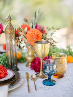 Inspired by the beauty of Morocco, Modern Dame set out to recreate that lavish, cozy vibe for a backyard luncheon with friends. With loads of pillows, lanterns and a wedding blanket under foot, the scene was set for a feast crafted by Haute Chefs Morrocan Theme Party, Morrocan Table, Indian Table, Moroccan Theme, Moroccan Wedding, Moroccan Colors, Moroccan Style, Dinner Party Decorations, Dinner Party Table