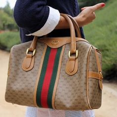 cdd186a3d {Gucci} Vintage Boston Bag authentic vintage Gucci Classi Boston bag in  monogram canvas. Suede interior with gold hardware and sporty stripe accent.