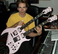 Steve Vai with a BC Rich double neck.  I haven't seen him hold anything but an Ibanez in many years, so this is interesting.
