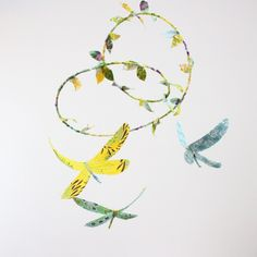 Dragonfly mobile - 3 dragonflies dream of spring in sunshine yellow, lavender purple, aquamarine, sky blue, sea foam green, white. $98.00, via Etsy.