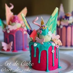 - Mini Drizzle Cakes covered in Colorful Buttercream and Colored Chocolate Sauce. With Colored Chocolate Chards, Chocolate Covered Strawberries and Sugar Butterflies on Top!  TAG a Cake Lover! - Cake by: @art_de_cake
