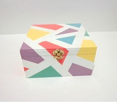 White & pastel geometric wooden jewelry box recipe box coral peach teal turquoise yellow lilac purple mint green blue jewellery storage so pretty! project for Lil's wooden jewelry box! Painted Trunk, Painted Wooden Boxes, Painted Jewelry Boxes, Hand Painted, Wooden Box Crafts, Cool Paper Crafts, Pintura Country, Contemporary Home Decor, Diy Box