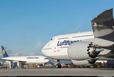 Two of the latest heavy additions to the Lufthansa fleet resting face to face at Frankfurt am Main