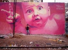 Pink wall art kid street art mural painting by street artist Martin Ron... unknown place