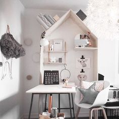 Adorable house shaped bookcase attached to desk in kids study area