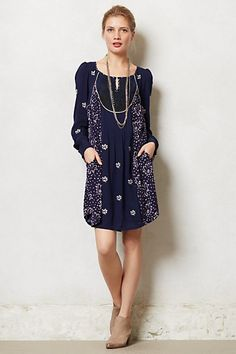 love the white print on indigo and casual shape; black front embroidery looks a little odd. would need to belt