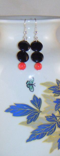"What's black & white and red all over? These earrings, with silver-plated hooks, a double black bead entente with tiny round red beads that herald the sun. Rising or setting, shed light on your ensemble with these eye-catching drops. Hangs 1 ½"" from hook.   https://www.etsy.com/listing/122506957/red-sun-drop-earrings?ref=v1_other_1"