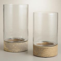 One of my favorite discoveries at WorldMarket.com: Natural Wood Base Glass Hurricane Candleholders