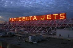 """Fly Delta Jets - you know that you are on the ground at Hartsfield when you see this sign.  To Atlantans, it may as well read """"Welcome Home.  Have Fun At Baggage Claim, Ya'll!"""".  LOL"""