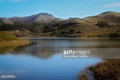 Stock Photo : Scenic View Of Lake By Mountains