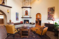 New Mexico Ranch. Fireplace seating ares. Warm and cozy room. Interior art and wall hangings by Marianne Williamson. For Sale. Click for more details.
