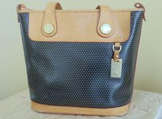 Vintage Dooney & Bourke Perforated Black by VintagePursesPlus, $98.00