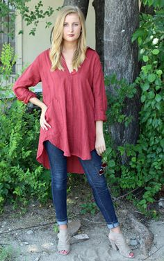 Teton Tunic – Raja Red Stripe by CP Shades  Pull on tunic top with open front placket, pointed collar & long sleeves. Back yoke with slight gathering. Button cuffs & curved shirt tail hemline. Front patch pockets. Rusty red with charcoal stripes.