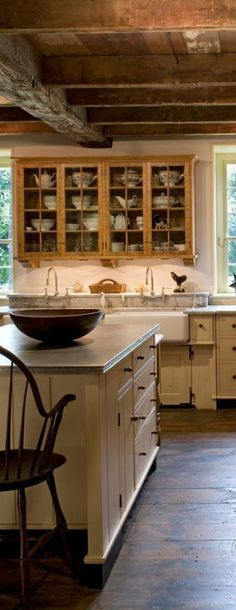 Know this is a repeat kitchen, but check out the color combination of dark wood floor, cream painted cabinetry, and white sink....