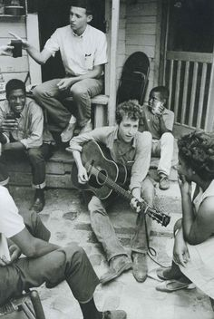 Bob Dylan plays on the back of the SNCC office in Greenwood, Mississippi, 1963.  Not the BAD, just tells us about it.