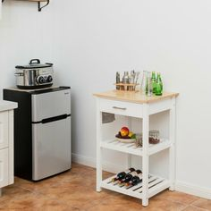 This thoughtfully designed kitchen cart is a perfect piece of furniture to help you reorganize your kitchen space! One large drawer and two open shelves provide ample storage for your kitchen and dining essentials. Diy Kitchen, Kitchen Dining, Kitchen Decor, Wood Cart, Kitchen Island Cart, Large Drawers, Apartment Kitchen, Display Shelves, Open Shelving