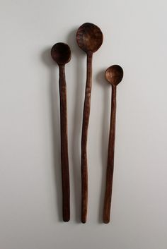 Hand carved from walnut wood, these long handled wood spoons are a kitchen must!