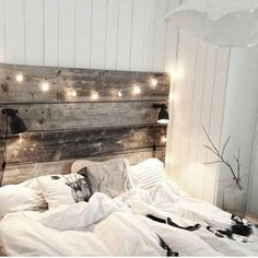 light up reclaimed wood headboard makes the bed cozier