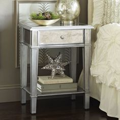 As glamorous as any star from Hollywood's Golden Era, yet as practical as we can make it, our Hayworth Nightstand is all about functional fashion. It's handcrafted, hand-painted and covered with bevel-cut mirrored surfaces, and its drawer and lower shelf give you practical storage for books, magazines or award show trophies. A Pier 1 Imports exclusive.