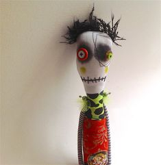 Anxiety relief ooak creepy cute art doll with button eyes and embroidered and painted details.