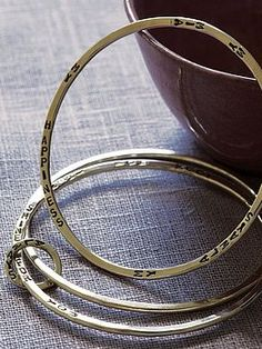 love these hammered silver bangles. (can be personalised!)