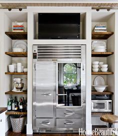 Incredible kitchen with stainless steel, industrial, glass front refrigerator…