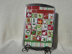 Fun magnetic Advent Calendar made on a cookie sheet.  By SimplyMemories on Etsy