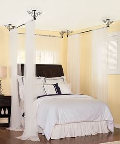 DIY- Fancy canopy bed. These are fascinating because they hang from the ceilling.  At 3 for $25, I am considerning using these instead of typical curtain rods/bed frame! #saving money #win