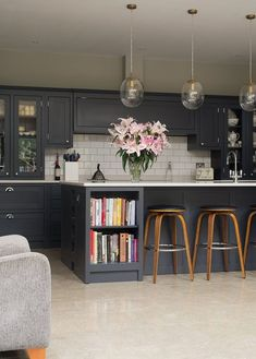 We went for dark wood kitchen designs, and the offer is diversified, so you can pick some of these according to what you wish for for your new kitchen, either built from scratch or that overdue kitchen remodel you have been saving for. Go modern, rustic or minimalist and contemporary, and your kitchen will look great according to our books but remember you have the last saying. The most important part is that among these dark wood kitchen designs you find the kitchen you have been looking… Shaker Style Kitchen Cabinets, Dark Grey Kitchen Cabinets, Shaker Style Kitchens, Kitchen Cabinet Styles, Painting Kitchen Cabinets, Kitchen Grey, Kitchen Pantry, Rustic Kitchen, Ikea Cabinets