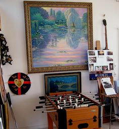 George Bleich paintings.  Jerry and I spent a wonderful afternoon at former studio located in Carmel talking to both George & his mother.  I still have the two signed prints we purchased.  George was the first modern, American impressionist painter to be allowed to paint in Monet's gardens.  One of our prints is similar to this one from his stay.  The other is a painting of Cypress point in Northern California.
