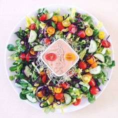 A dream bowl for lunch!!! - massive salad with CREAMY STRAWBERRY dressing. Salad: romaine, lamb lettuce, purple cabbage, alfalfa sprouts, mixed baby tomatoes, cucumbers, little bit red onion. Dressing: half zucchini peeled, teaspoon of tahini, 1garlic clove (I use fermented for easy digestion), 1celery stalk, 1mango cheek, 1 cup frozen or fresh strawberries, juice of half lemon and half orange, 2-3 presoaked dates for extra. #dehappy5_mama