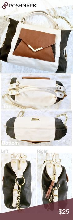 Steve Madden versatile cross body purse Colors: cream, brown, and black with gold accents. Condition: used. Has visible wear on the cream colored portions of the bag if you look closely. Has small scratches on the gold accents. Has one pocket with a zipper and two open pockets on the inside. Features a stylish envelope style pocket in brown on the front. Includes a detachable leather/chained cross body strap. The contrasting colors of this bag really make it pop! Easy colors to match with…