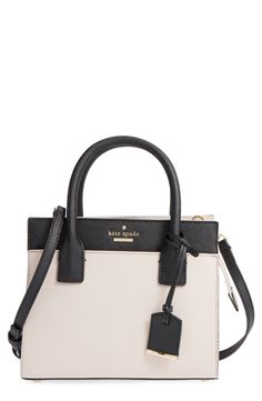 Clean color blocking, painted edges and crosshatched leather composition define this well-structured satchel from Kate Spade that'll go with any look.