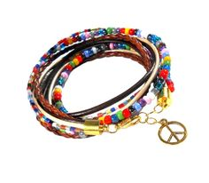 Bracelet hippie Bright colors, beads, braids and peace symbol that is 21th century hippie style.  Feel the atmosphere of Woodstock!    ButikHejHej - Bransoletki zwijane