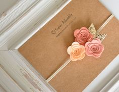 These flowers is so sweet and delicate made soft wool felt. They come attached to a soft and comfort