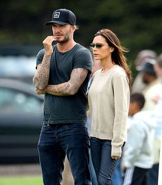 David and Victoria Beckham dress down in denim to watch their sons play in a youth game at Reading FC training ground