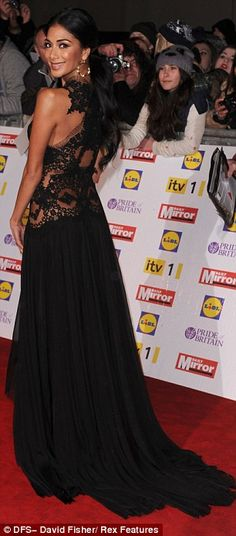Showstopping: Nicole Scherzinger oozed red carpet glamour in her daring thigh-split black lace-detail gown