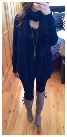 Day to evening outfit for Fall or Winter - oversized sweater over black dress with scarf, leggings, and tall boots.