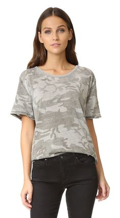 On SALE at 35% OFF! army tee by Free People. A casual Free People tee with a muted camo print. Split hem. Raw edges and short sleeves. Fabric: Jersey. 50% cotton/...